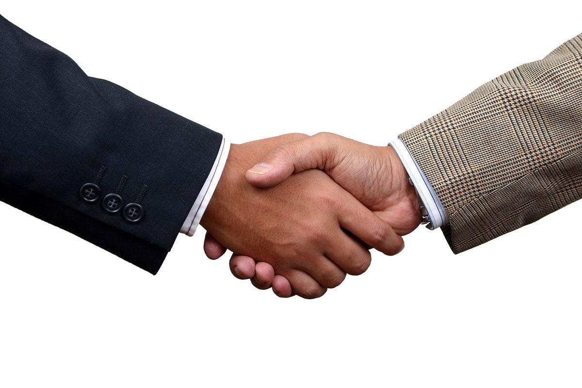 Cheesy handshake stock photo
