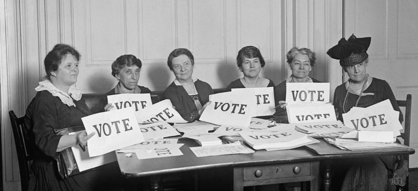 National League of Women Voters hold up signs reading, 'VOTE', Sept. 17, 1924.